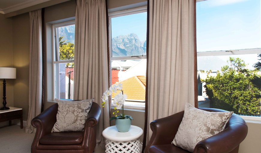 Our Luxury rooms either overlook the foot of Signal Hill through an elegant bay window or boast a quaint balcony overlooking the mountains and the sea.