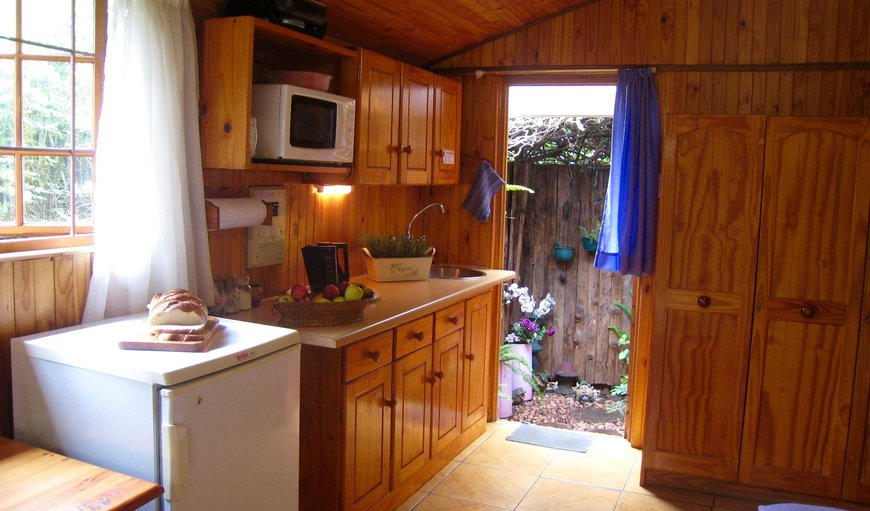 The Cabin's fully equiped kitchenette with fridge, microwave, kettle, toaster and all utensils.