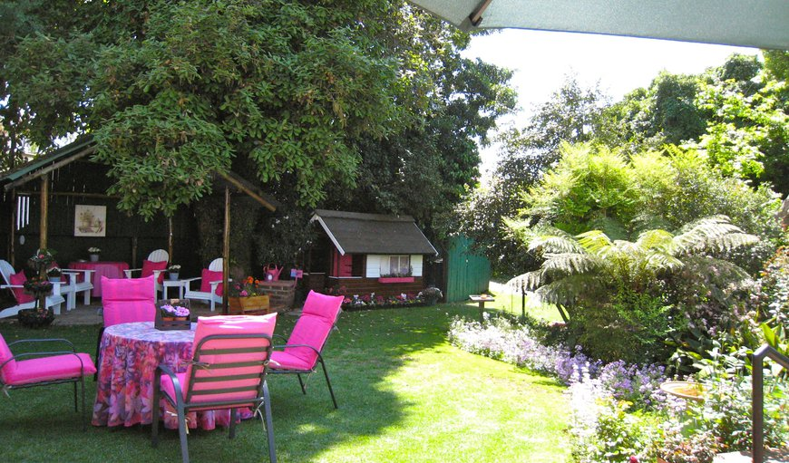 Top garden with gazebo, BBQ facilities and doll's house.