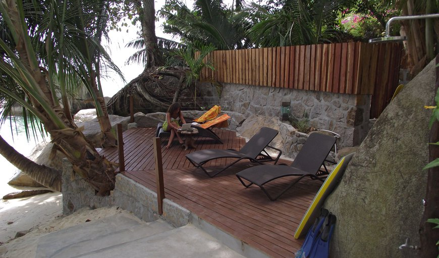 Sundeck with deckchairs and beachside  shower
