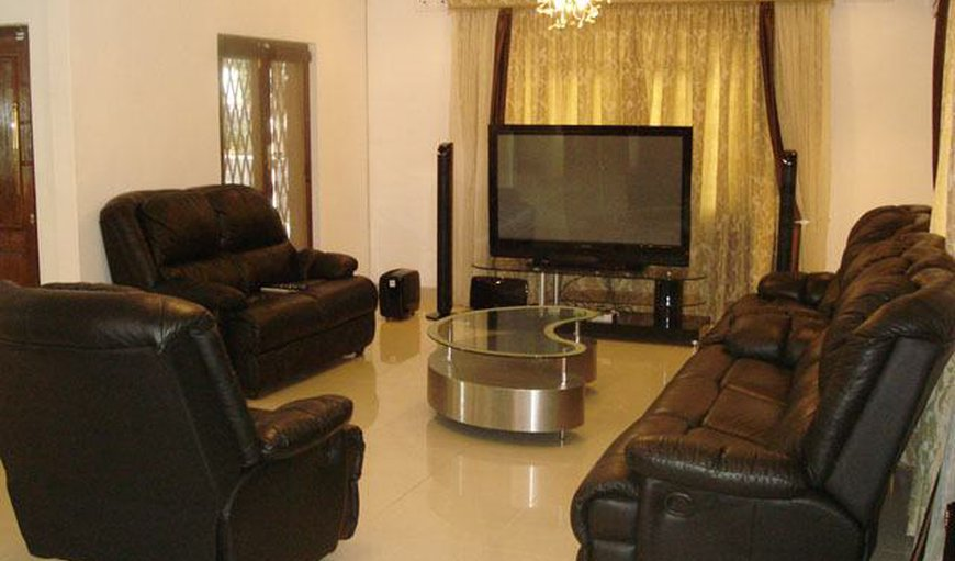 The ideal 8 Seater lounge with black leather couches & an awesome 72' Flat screen TV, ideal to watch those Rugby games on.