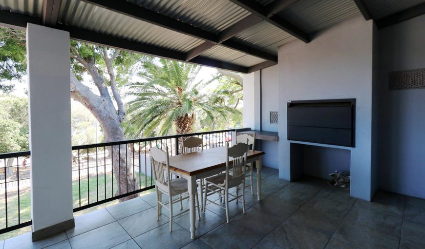 Oceana Beach- Shaded Patio: Massive undercover patio with patio furniture and build in bbq braai fireplace, deck chairs and outside table.