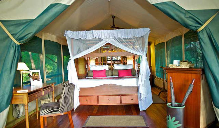 Luxury Tented Camp - The spacious tents offer 4-poster beds that are either a queen size bed or two twin beds and an en-suite bathroom.