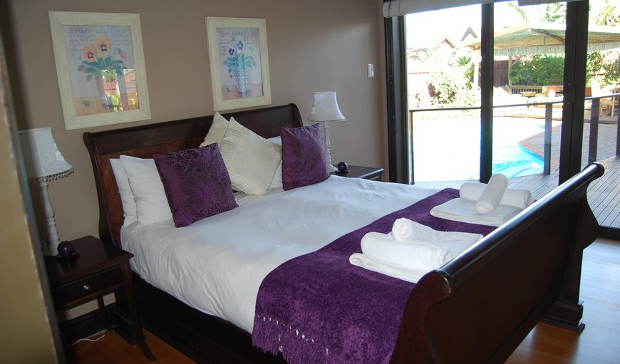 Pool facing Double Room with Queen size sleigh bed and en-suite bath and shower. Private entrance, air conditioning, fridge, tea/coffee, DSTV.