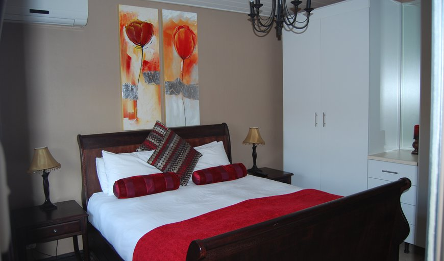 Main bedroom with Queen size sleigh bed, walk-in shower. Large wardrobe. Air conditioned. Open plan kitchen leading into living room with single bed + pull-out single bed, fully equipped kitchen with fridge/freezer, microwave, with DSTV. Private entrance.