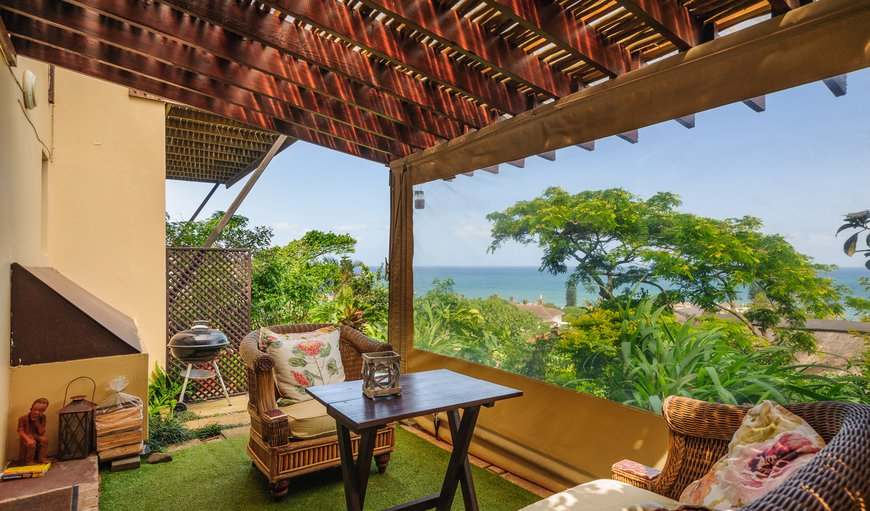 Private Patio to enjoy lush gardens and sea views.
