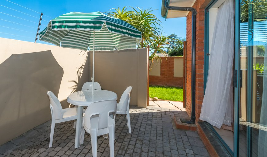 2-Bedroom Unit: outside patio with table, chairs, umbrella and outside   BBQ facility
