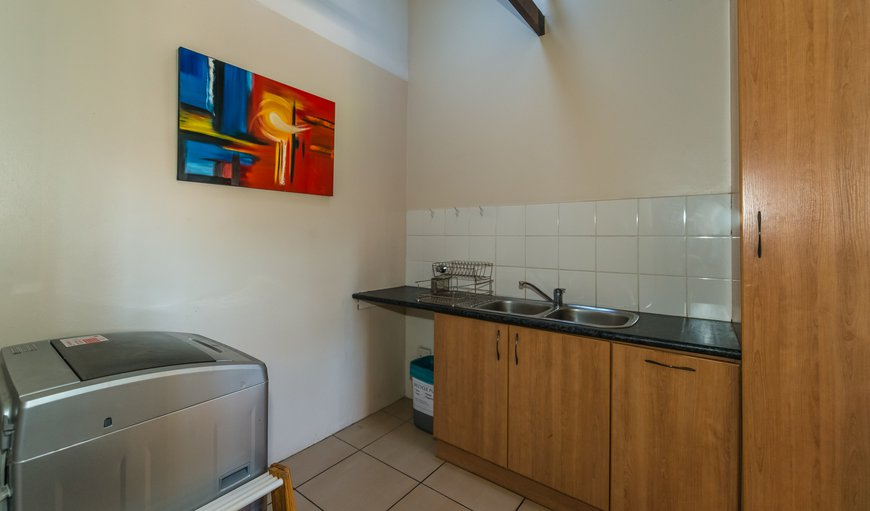 2-Bedroom Unit: Scullery with basin, and washing machine
