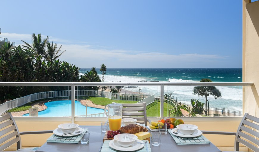 The unit offers a balcony overlooking the ocean. in Ballito, KwaZulu-Natal, South Africa