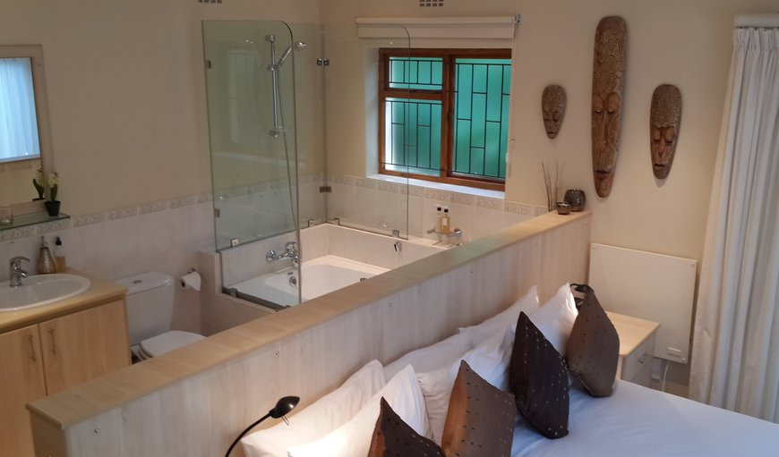 This room has a open plan full bathroom - toilet is not enclosed but behind the wall.  More suitable for single occupancy or established couples who do not mind this open plan set up.