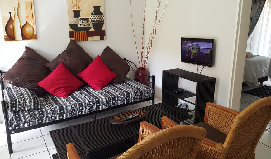 Open plan lounge with selected DSTV in Nelspruit, Mpumalanga, South Africa