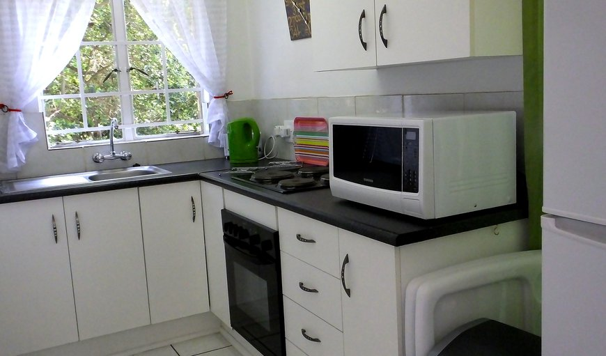 Fully equipped kitchen in 4 sleeper units, with Stove, Oven, Microwave, Fridge/freezer.