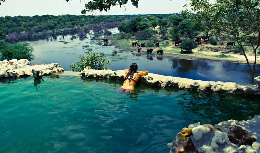 Outside there's a lovely plunge pool created from natural rock formations, which overlooks the river.