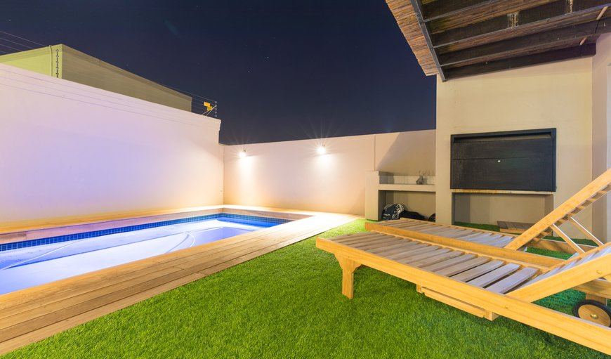BBQ & pool area with artificial grass