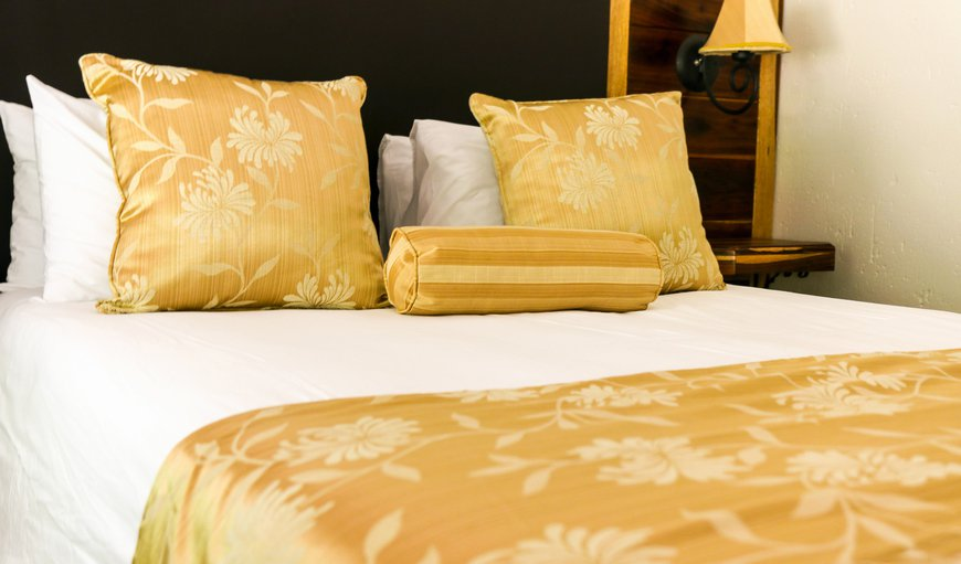 Extra-length Queen sized beds with quality linen
