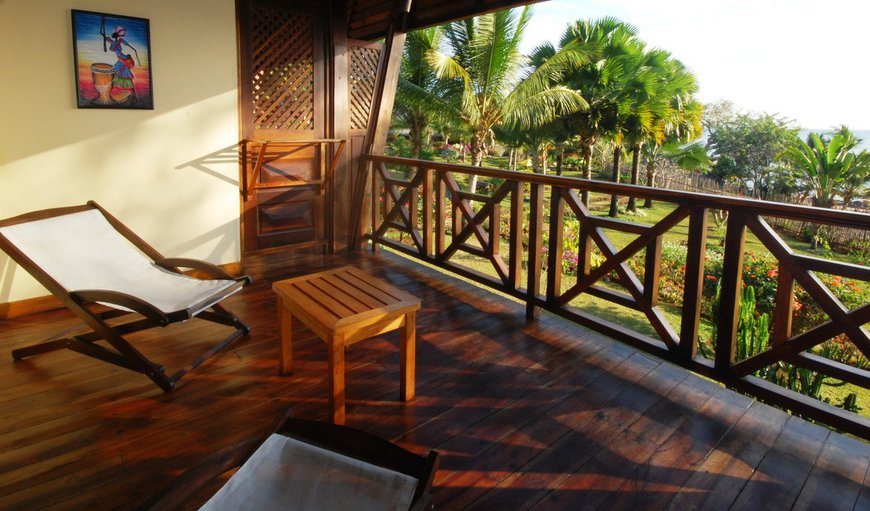 Private balcony overlooking tropical garden & indian ocean