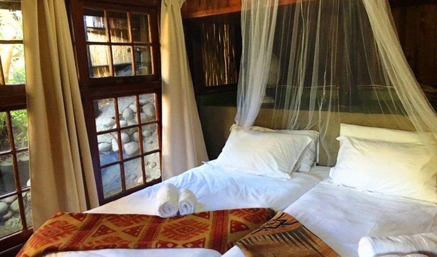The I Khaya  twin bedded room is bright and sunny with a Victorian Slipper bath en suite and a little private garden with table and chairs.