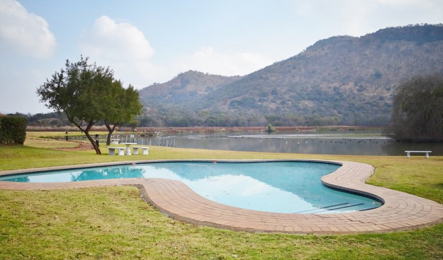 Swimming pool at communal entertainment area overlooking the Crocodile river. in Hartbeespoort Dam, Hartbeespoort, North West Province, South Africa