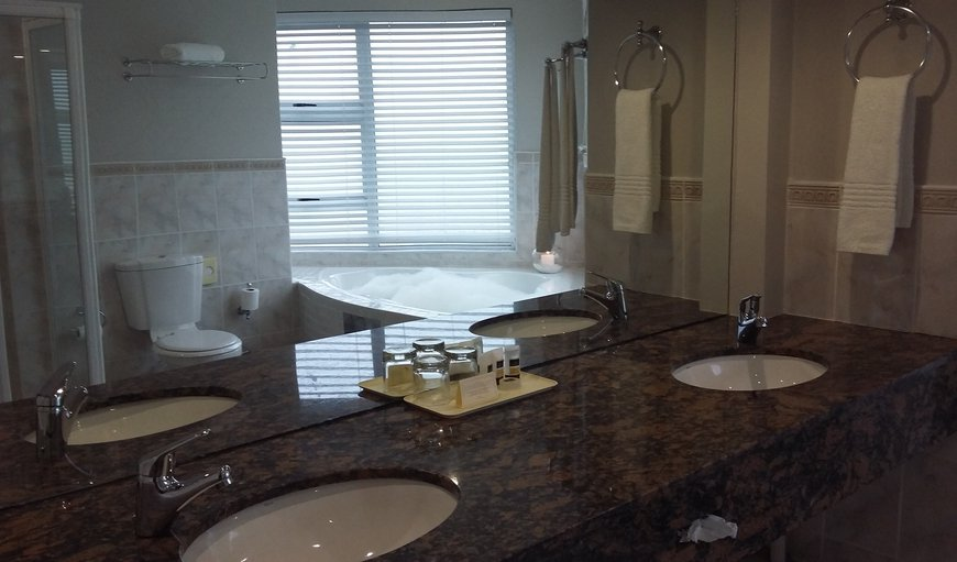 Bathroom with double amenities and separate bath and shower