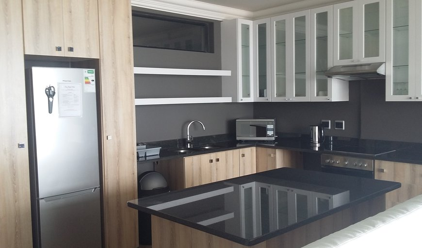 Self catering unit's open plan kitchen.