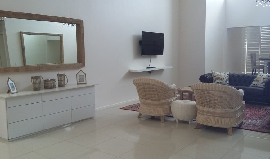 Penthouse self catering apartment's open plan lounge & diningroom area