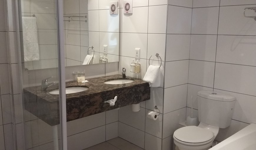 Newly upgraded bathrooms with separate bath, shower and twin amenities