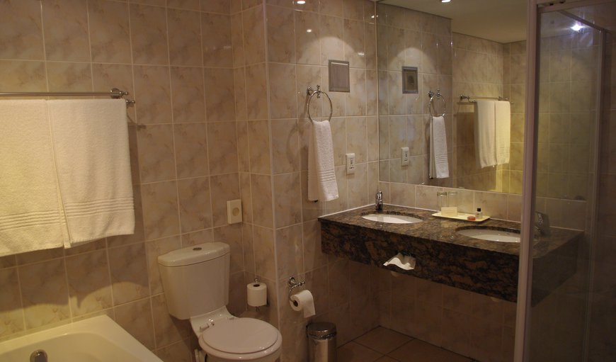 All bedrooms' bathrooms have double vanities with separate bath and shower.
