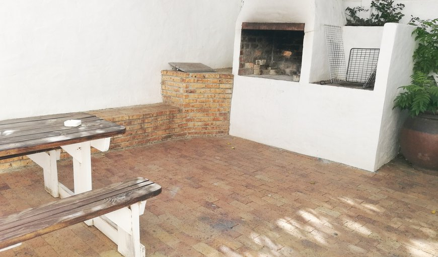 Residents love our courtyard braai area.  There are tables and chairs, plus we provide grids and untensils, and the kitchenette has all the plates and cutlery you need.