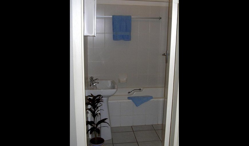 The room has an en-suite bathroom with bath and shower