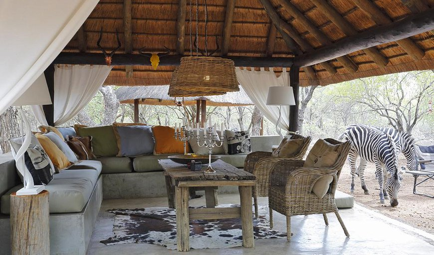 The lodge offers a communal outdoor lounge area. in Marloth Park, Mpumalanga, South Africa