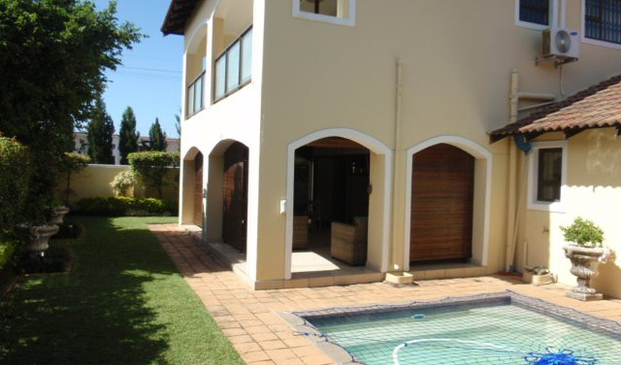 Outside area with garden and swimming pool  in Umhlanga Rocks, Umhlanga, KwaZulu-Natal , South Africa