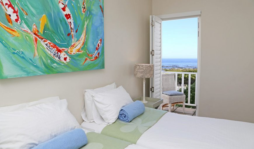 Quaint room with king size bed (or two twin beds) with a lovely view of the ocean and a door leading onto a small private ocean facing balcony; mountain and pool views, and a shower in the en suite bathroom.