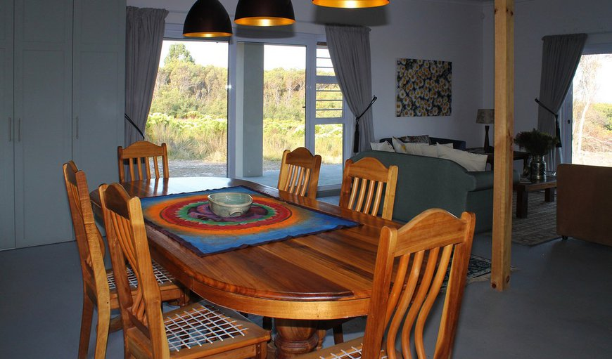 Blombos House - dining table in living room