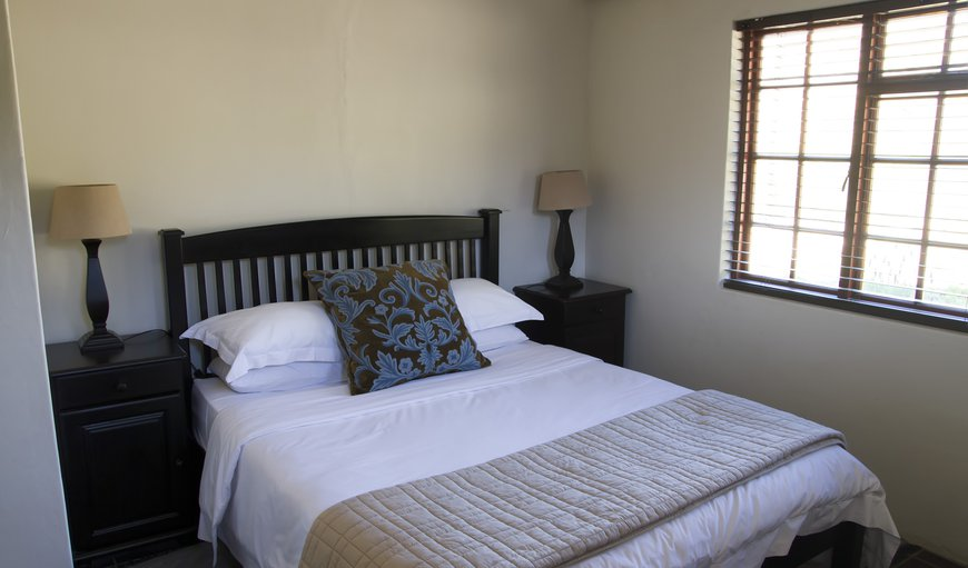 Mountain view cottage bedroom with double bed.