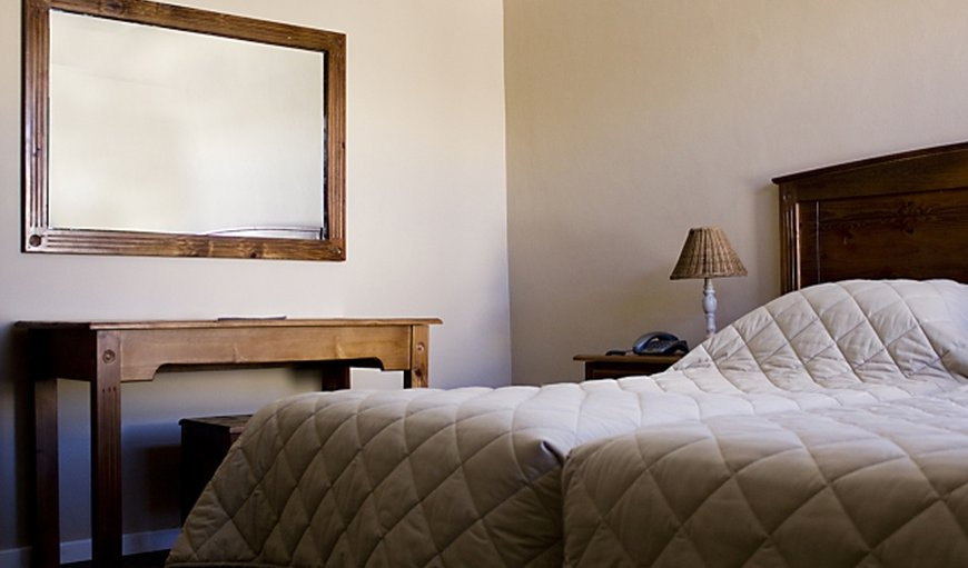 This room is furnished with twin beds. The room features air-conditioning, TV and tea- and coffee-making facilities.