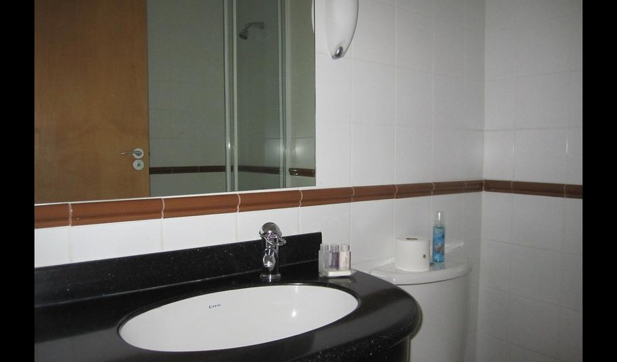 Room 214 with an en-suite full bathroom with amenities.