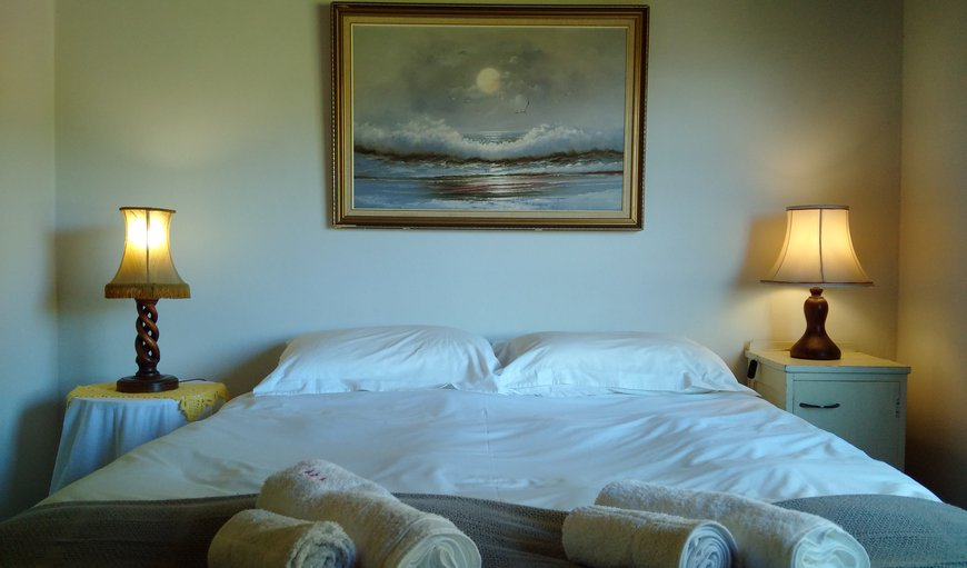 Queen size double bed in room one