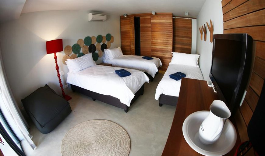 Each room features a double bed/Twin Bed and en-suite bathroom. In-room amenities include air-conditioning, a TV with selected channels, and wireless Internet access.