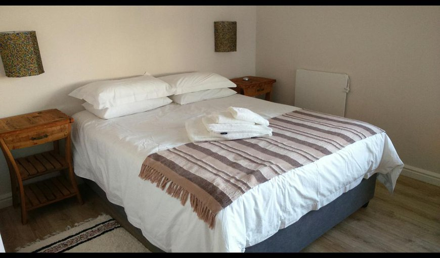 The Main bedroom is spacious with a Queen-sized bed and en-suite bathroom