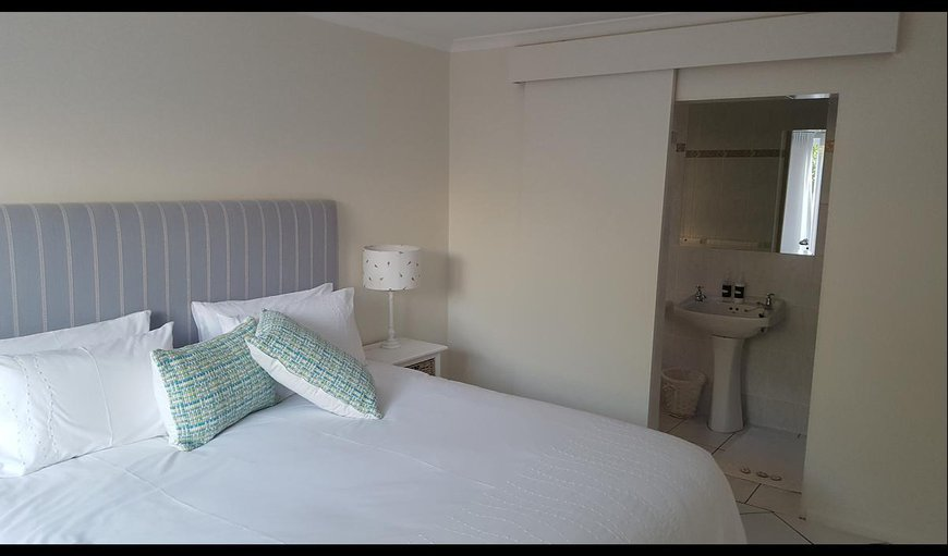 The upstairs main bedroom has an en-suite with bath and shower