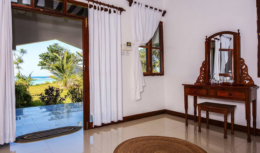 Every room is set in an individual private bungalow each with its own spacious private veranda and furnished with: hot shower, mosquito nets, air conditioning, ceiling fan, digital safe box, and mini fridge, hair dryer, wardrobe and desk. All rooms have a private veranda.