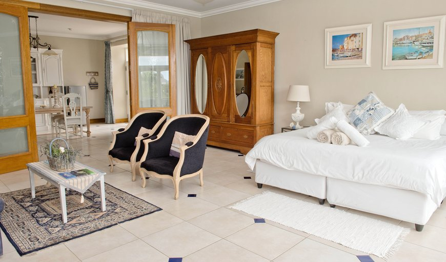Main room - with King size bed, lounge area and opening up to mountain and sea views.