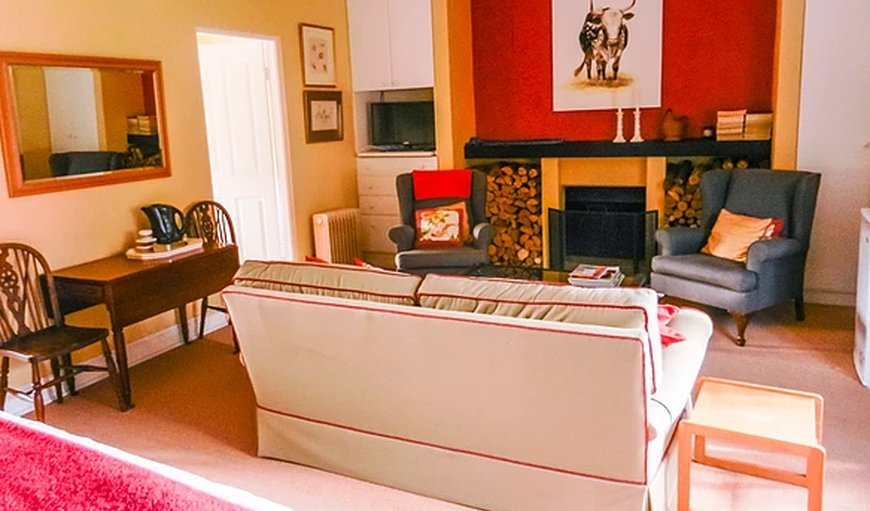 Feathers Cottage - Lounge with fireplace