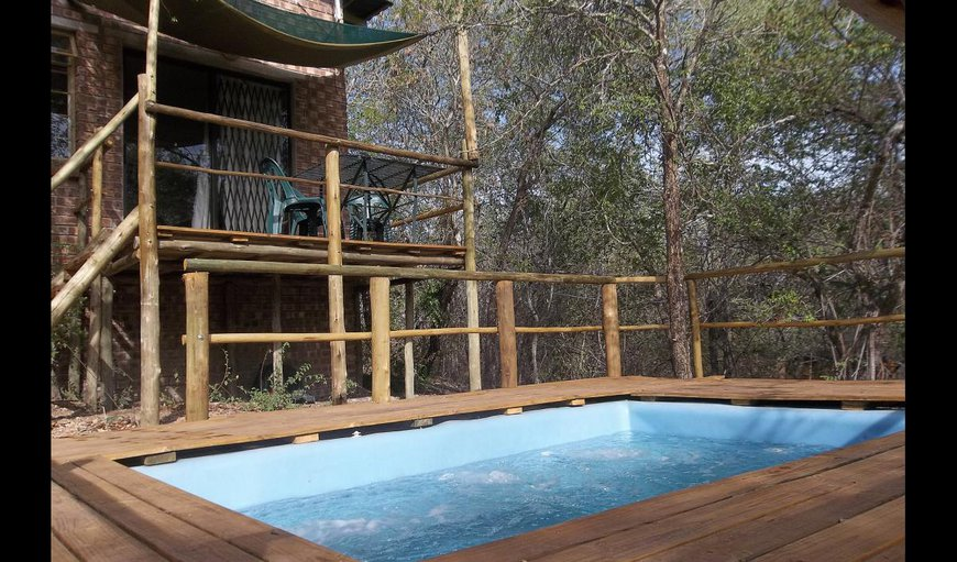 Bush Cabana with a spa-hydro swimming pool.