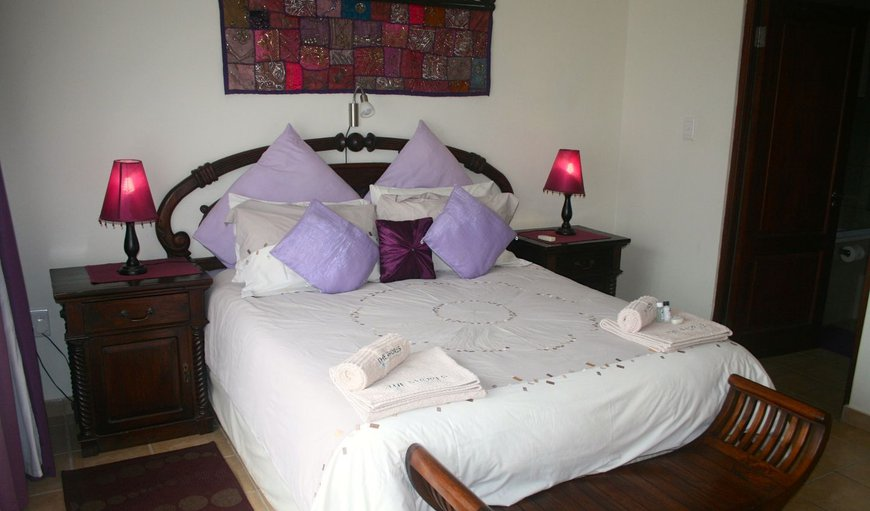 The main bedroom has a Queen-sized bed with an en-suite bathroom