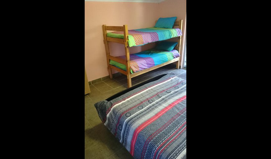 The 3rd room has a Queen-sized bed with a bunk bed