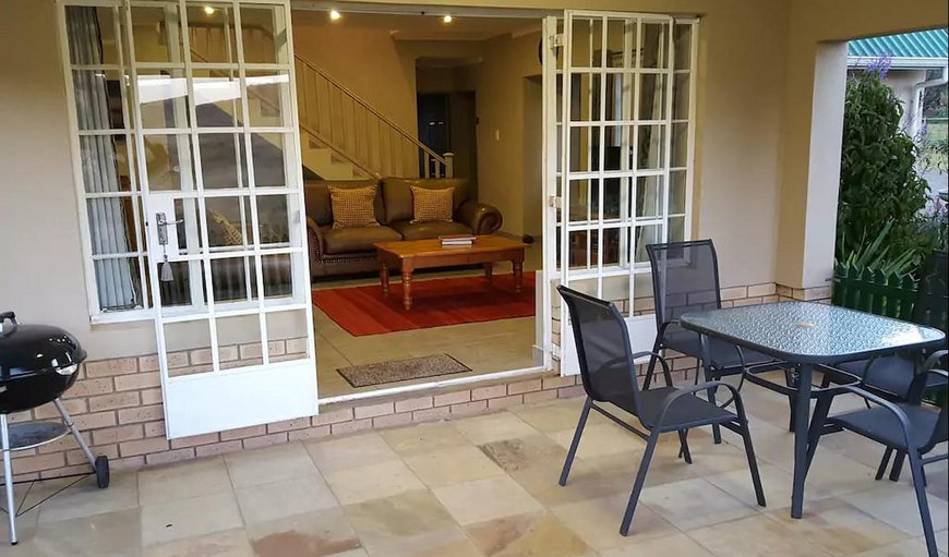 Verandah with outdoor seating and Weber braai. Please bring own charcoal.