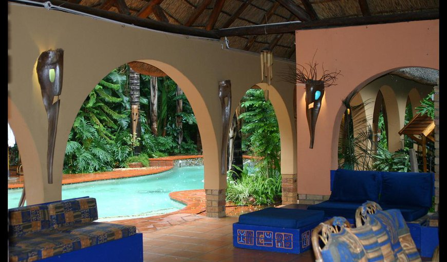 A Bohemian Rhapsody shared lounge area by the swimming pool.