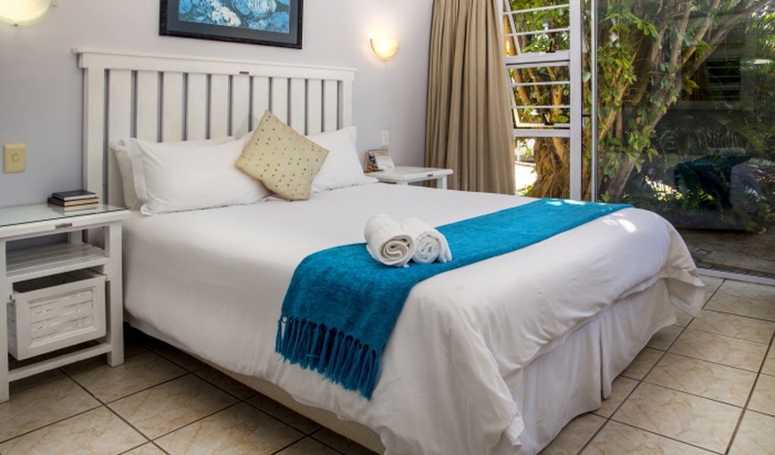 The rooms are furnished with white linen and warm decor