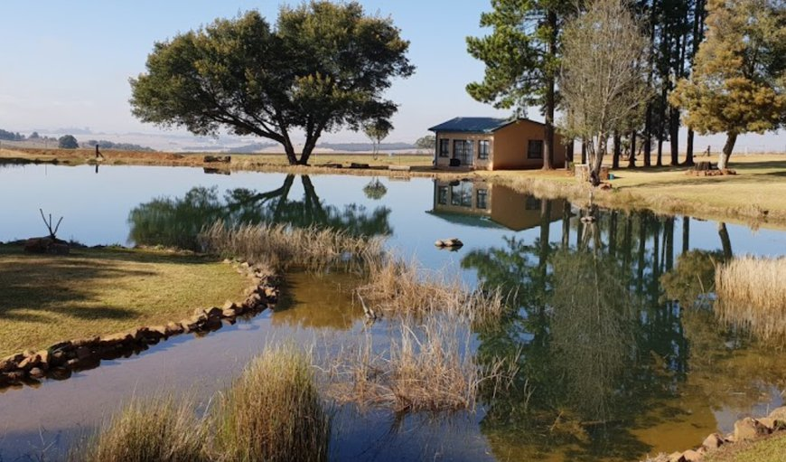 Cottage set on beside the farm dam in Machadodorp, Mpumalanga, South Africa
